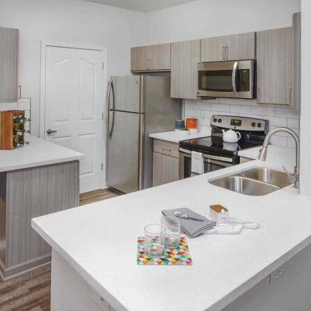 Kitchen with ample appliances at The Grove at Orenco Station in Hillsboro, Oregon