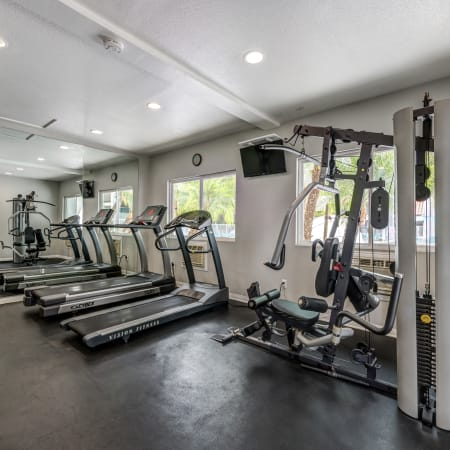 fitness center with cardio machines at Kendallwood Apartments in Whittier