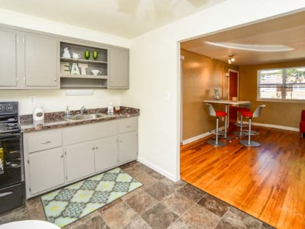 Model kitchen and dining room at Wedgewood Hills Apartment Homes
