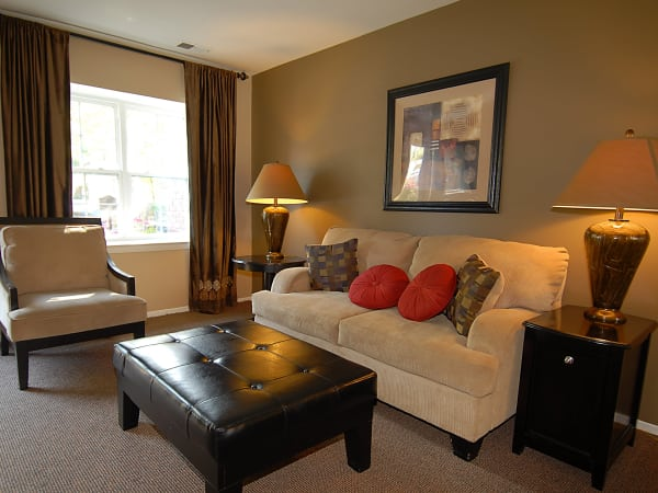 Model living room tastefully decorated at Arbors at Edenbridge Apartments & Townhomes in Parkville, MD