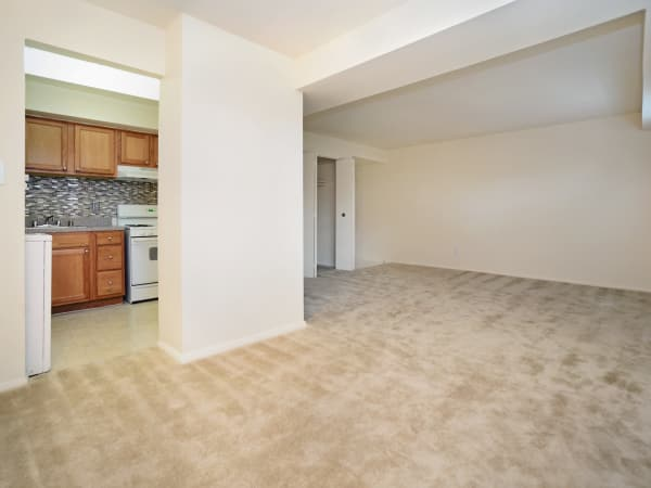 Spacious living room at Arbors at Edenbridge Apartments & Townhomes in Parkville, MD
