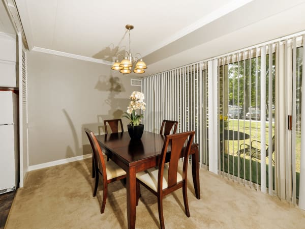 Dining room area with sliding glass doors at Willowbrook Apartment Homes in Baltimore, MD