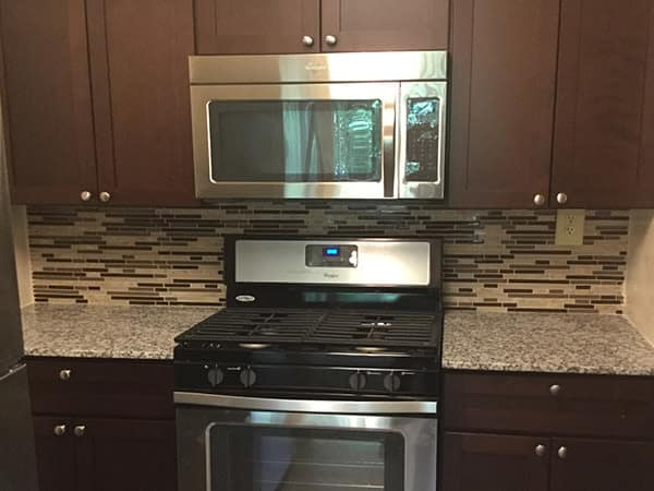 Kitchen at Willowbrook Apartment Homes featuring microwave and oven in Baltimore, MD