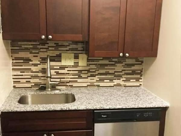 Kitchen with sink and dishwasher at Willowbrook Apartment Homes in Baltimore, MD