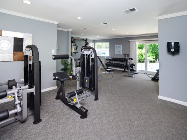 Modern fitness center at Quail Hollow Apartment Homes in Glen Burnie, Maryland