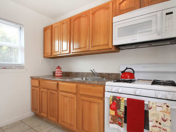 Elmwood Village Apartments & Townhomes offers a modern kitchen in Elmwood Park, New Jersey