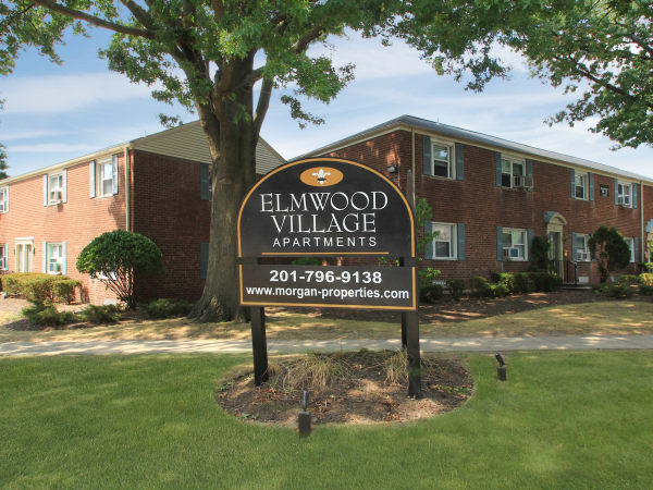 Main sign at Elmwood Village Apartments & Townhomes in Elmwood Park, New Jersey