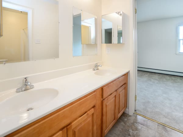 Dual sing bathroom at Vineland Village Apartment Homes in Vineland, New Jersey