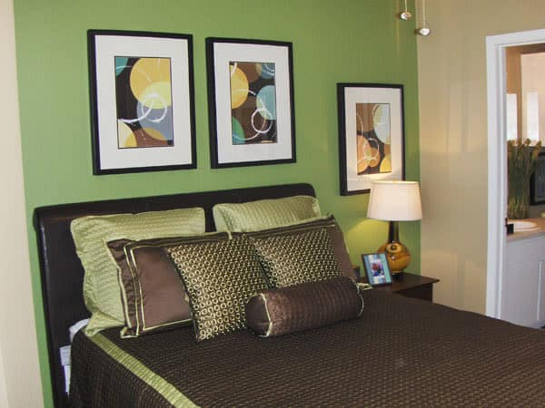 Well decorated bedroom at Greentree Apartments in Carrollton