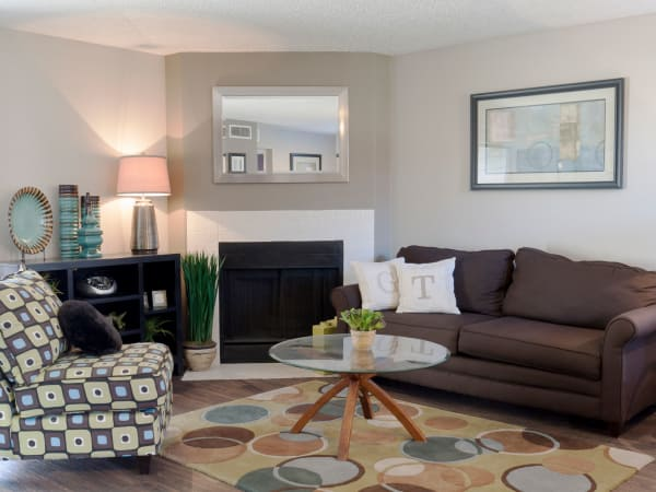 Enjoy apartments with a natrually well-lit living room at Greentree Apartments