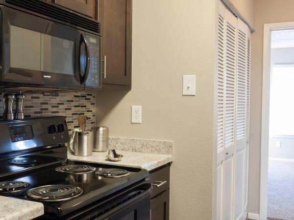 Greentree Apartments offers a beautiful kitchen in Carrollton, Texas