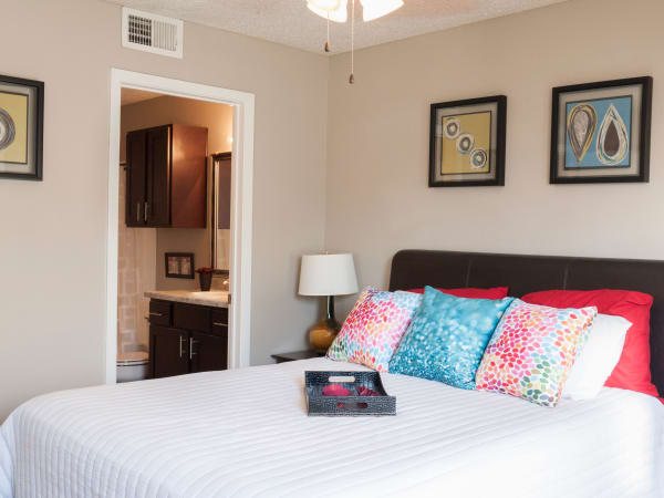 Natrually well-lit bedroom at apartments in Carrollton, Texas