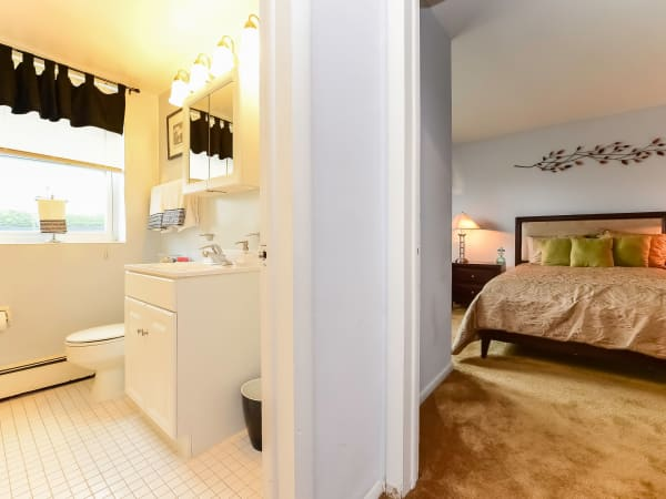 Bathroom & Bedroom at Hyde Park Apartment Homes in Bellmawr, New Jersey