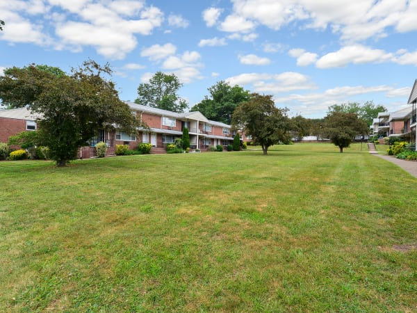 Lush Grass Area at Rolling Gardens Apartment Homes   Apartments in Mahwah, New Jersey