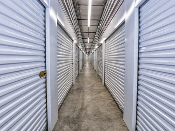 Hallway of units at StorQuest Self Storage in Aurora