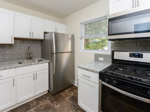 Kitchen at Elmwood Village Apartments & Townhomes in Elmwood Park, New Jersey