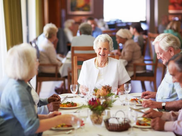 A group of residents eating at Patriots Landing in DuPont, Washington.