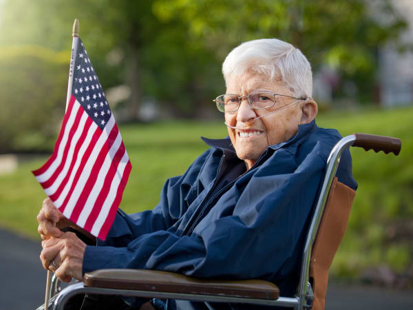 A veteran holding a flag at Patriots Landing in DuPont, Washington.