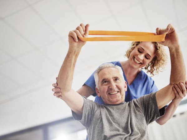 A Careage staff member helping a resident with his health and fitness.