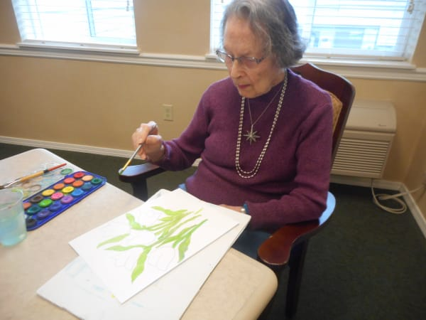A resident making art at Patriots Glen in Bellevue, Washington.
