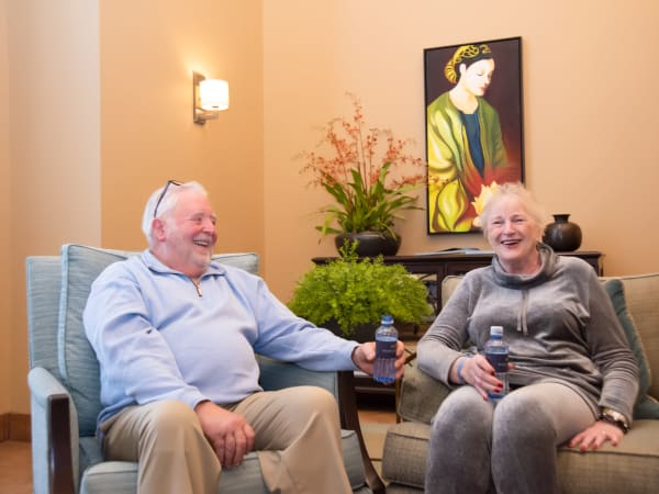 Two residents chatting at Mission Healthcare at Bellevue in Bellevue, Washington.