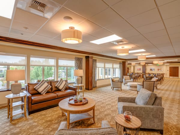 Spacious lounge with big windows at Mission Healthcare at Renton in Renton, Washington.