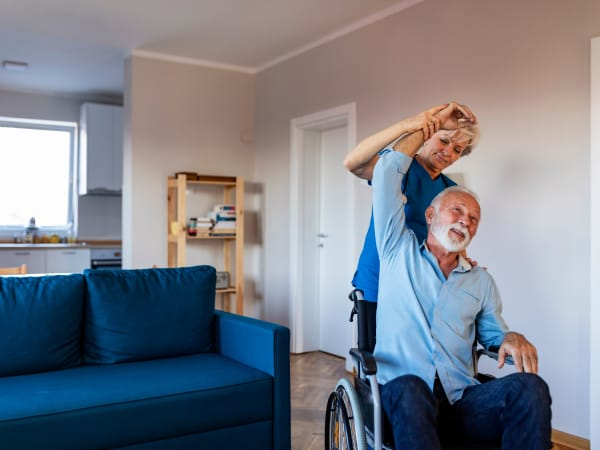 A health professional helping a patient stretch at Careage Home Health in Lakewood, Washington.