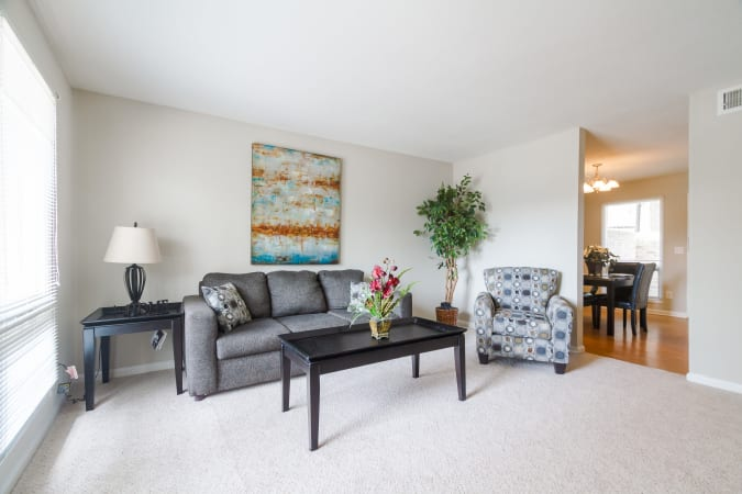 Living room area at Castlegate Windsor Park Apartments in Columbus