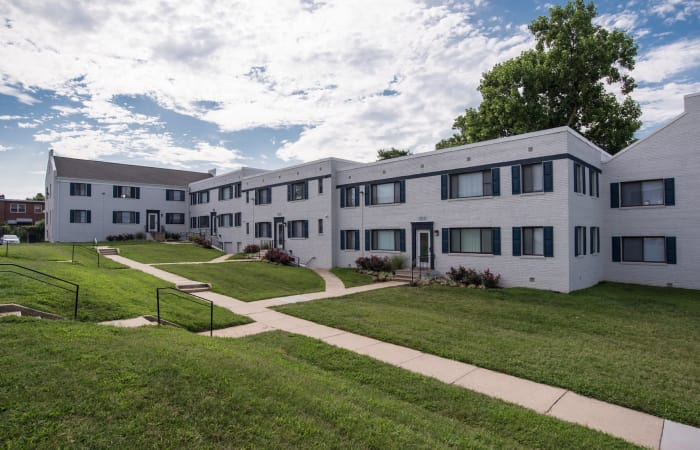 Well-maintained landscaping and pathways among resident buildings at The Residences at Silver Hill in Suitland, MD