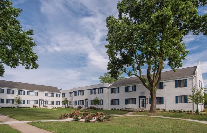 Beautiful trees and well-maintained landscape outside resident buildings at The Residences at Silver Hill in Suitland, MD