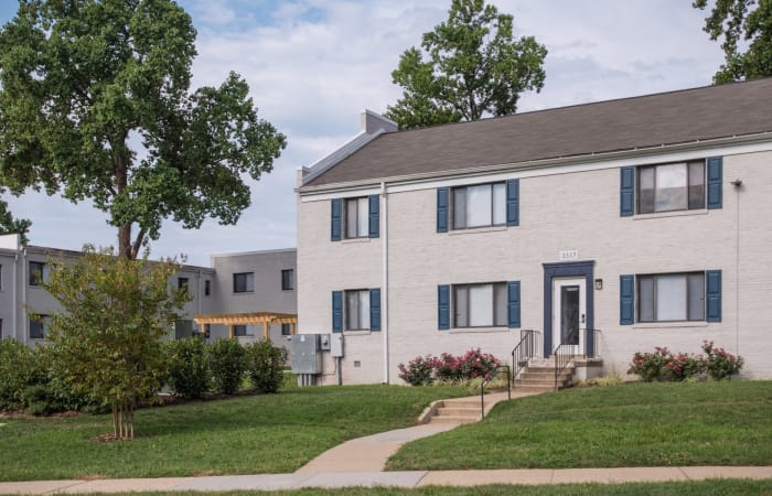 Closer view of exterior resident building and well-manicured lawn at The Residences at Silver Hill in Suitland, MD