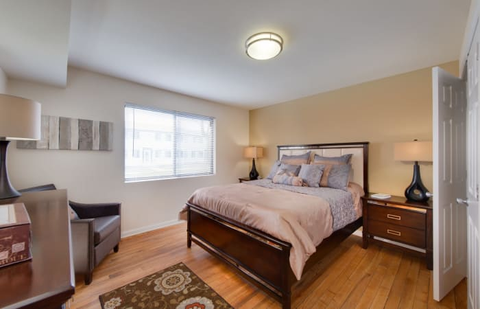 Spacious master bedroom with hardwood floors at The Residences at Silver Hill in Suitland, MD