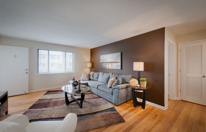 Modern decor and hardwood floors in model home at The Residences at Silver Hill in Suitland, MD