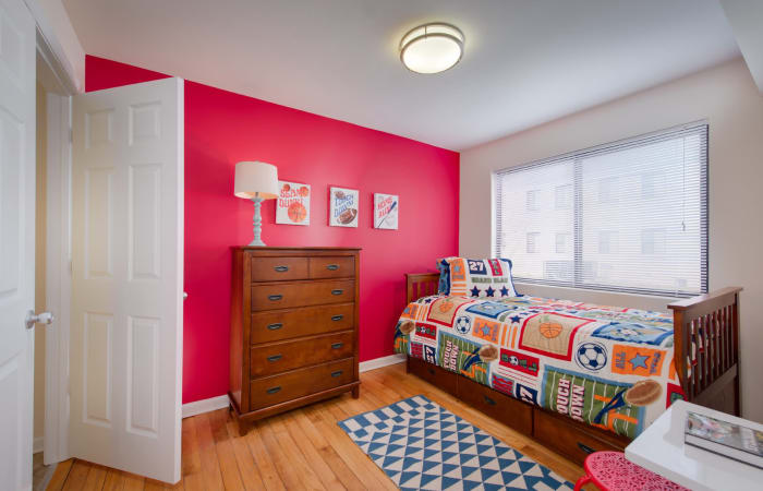 Child's room with bright paint and furnishings in model home at The Residences at Silver Hill in Suitland, MD