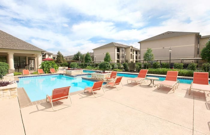 Plenty of comfortable seating near the pool area at Camden Lake Apartments in Baton Rouge, LA