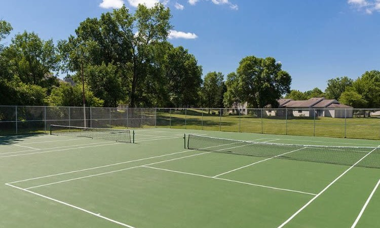 Penbrooke Meadows Apartments' tennis court in Penfield, NY