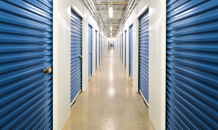 Clean and well-lit storage unit hallways at Hawai'i Self Storage in Pearl City