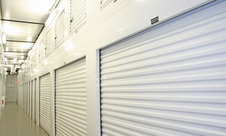 Clean and well-lit interior storage unit hallways at Hawai'i Self Storage in Kapolei