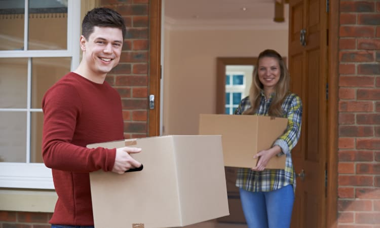Couple moving into their new home in Las Vegas, Nevada near Towne Storage
