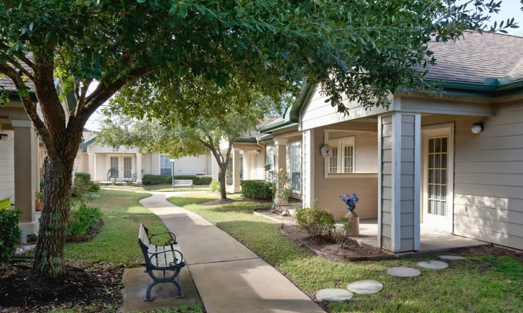 Apartment home patios and beautiful landscaping and walkways at Carriage Inn Huntsville in Huntsville, Texas