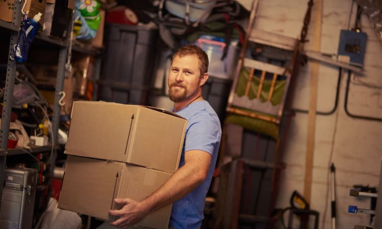 Man moving boxes at Grand Slam Self Storage in St. Louis, Missouri