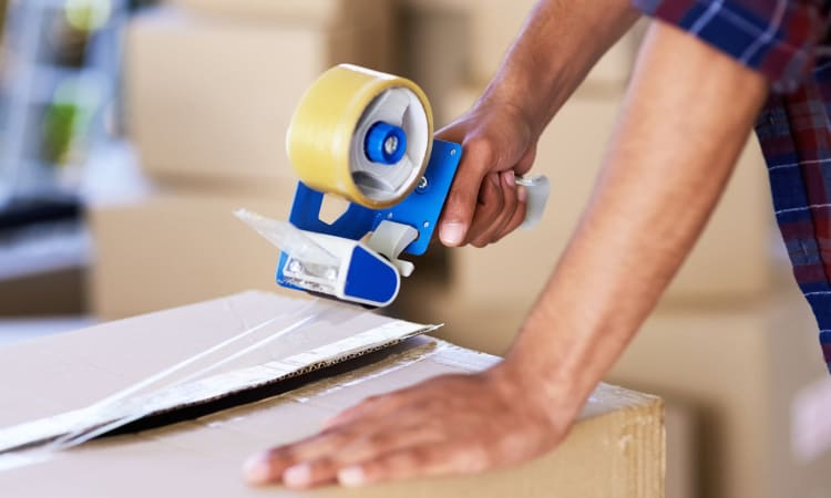 Taping up a box at Grand Slam Self Storage in St. Louis, Missouri
