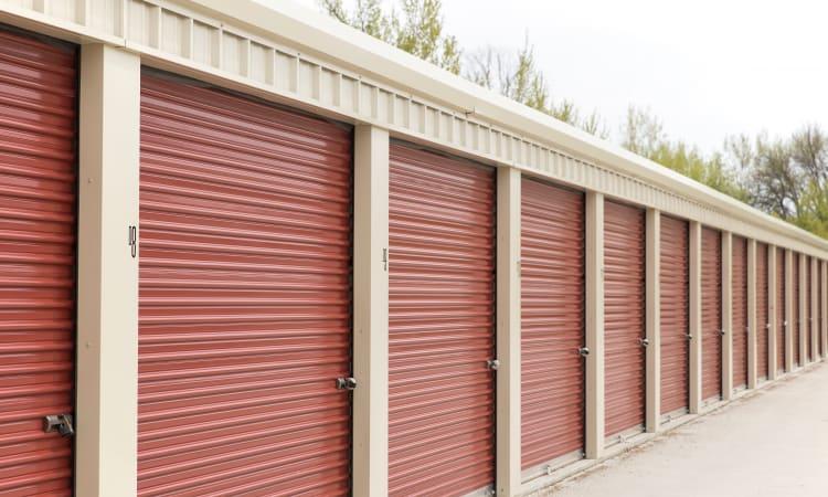 Red doors on outdoor storage units at EZ Storage in Des Moines, Iowa