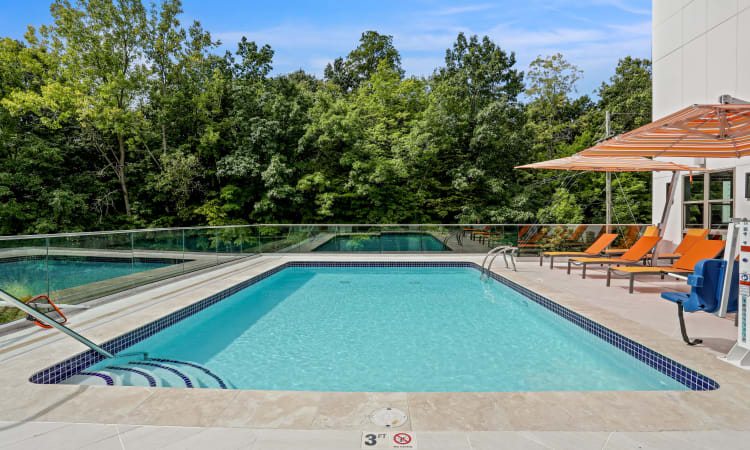 Resident enjoying her day at the pool at Town Court in West Bloomfield, Michigan