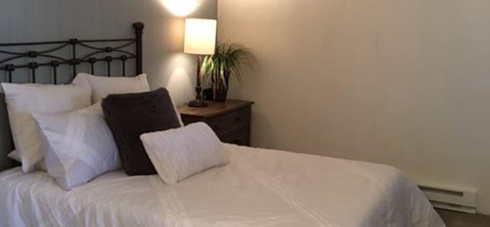 Cozy bedroom at Vista Alegre apartments in Santa Fe