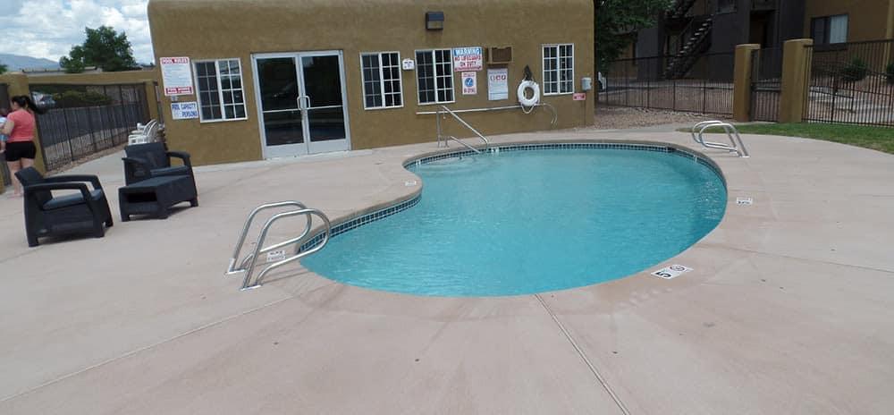 Sparkling swimming pool at Vista Alegre apartments in Santa Fe