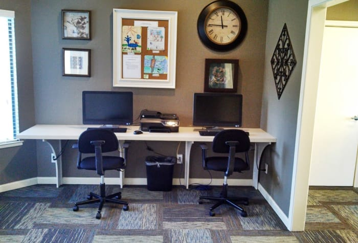 Business center with computers for resident use at Waterfield Square Apartment Homes in Stockton, CA