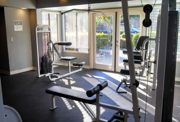 Well-equipped fitness center at Waterfield Square Apartment Homes in Stockton, CA