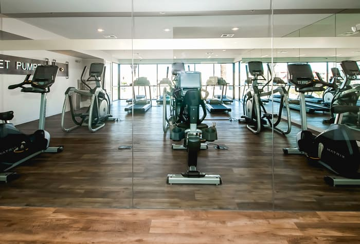 Plenty of equipment to help residents get and stay fit in onsite fitness center at IMT Sherman Circle in Van Nuys, CA