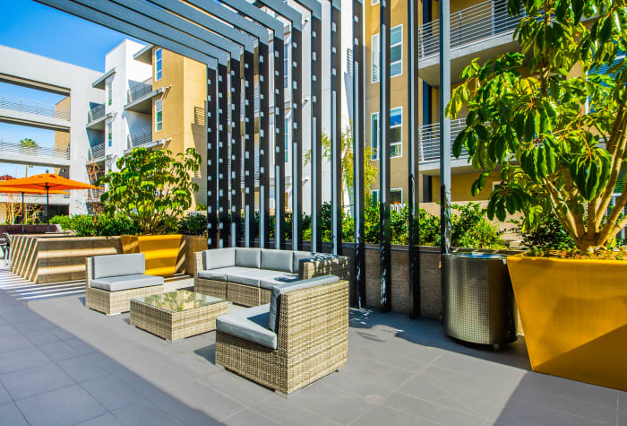 Exterior common area with comfortable seating at IMT Sherman Circle in Van Nuys, California